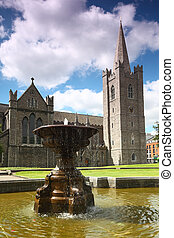 Fountain near St.Patrick's Cathedral in Dublin, Ireland, blue sky and clouds