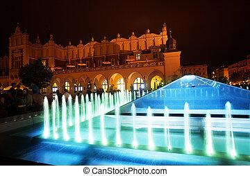 Fountain of Cloth Hall on Rynek Glowny in Krakow
