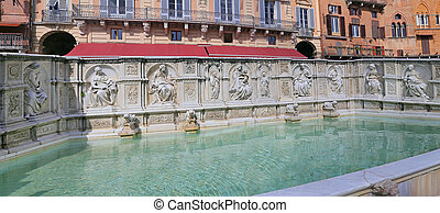 Fountain of joy - a medieval marble fountain in Siena. Panel Fonte Gaia, Piazza del Campo, Siena, Tuscany, Italy