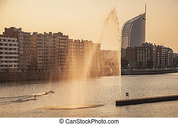 Fountain on Meuse River in Liege. Liege, Wallonia, Belgium.