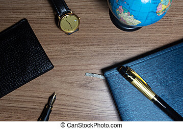 Fountain pen, antique watch and other objects in ...
