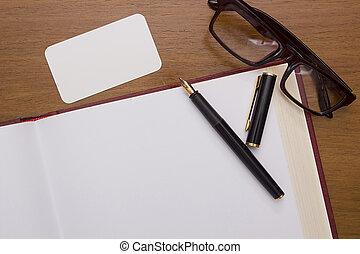 Fountain pen on an open book