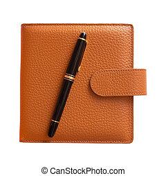 Fountain pen on diary isolated
