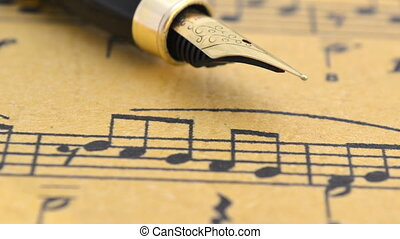Fountain pen on music sheet dolly shot