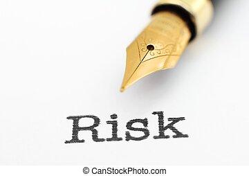 Fountain pen on risk text