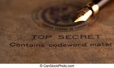 Fountain pen on top secret document