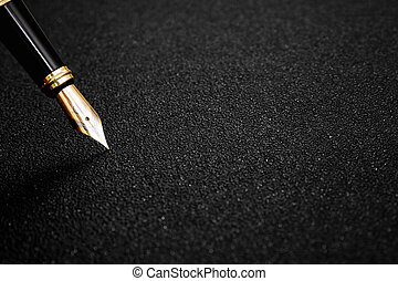 Fountain Pen with clipping path on black textured background...