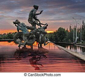 Fountain sculpture in sunrise light