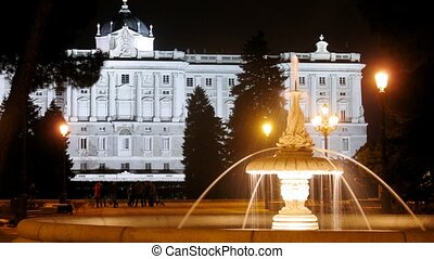 Fountain stands in front of king palace at night, time lapse