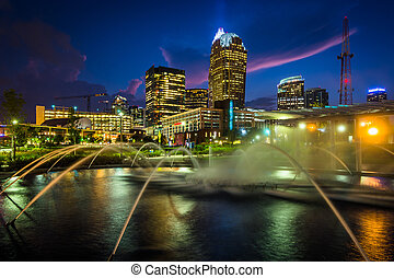 Fountains and the Charlotte skyline at First Ward Park at ...