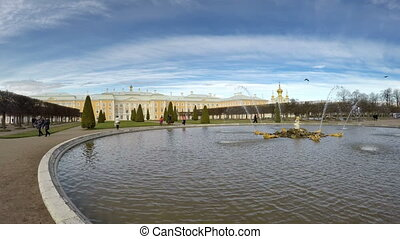 Fountains of the top park and dome of the palace in Peterhof park  in Petrodvorets, Peterhof, Russia