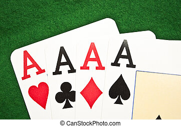 Four aces macro shot on green background