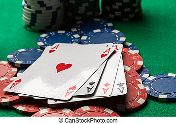 four aces on poker chips