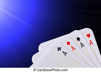 Four aces - Close up of poker hand of four aces against blue...