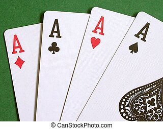 Four Aces - Playing cards on a green background.