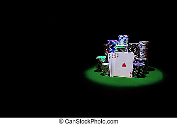 Four aces with gambling chips on green casino table