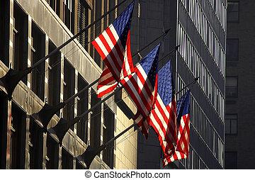 Four american flags against a building, manhattan, new york,...