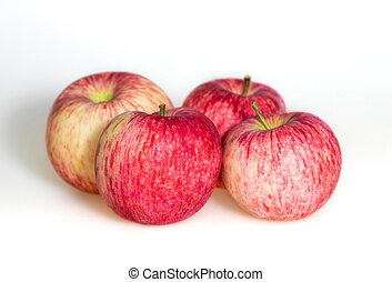 Four apples on white background. Red juicy ripe apples close up. Fresh striped fruit. Side view.