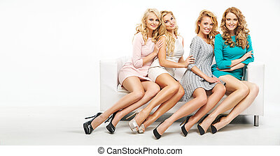 Four attractive ladies posing together