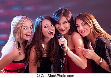 Four beautiful girls singing karaoke - Four beautiful...