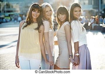 Four beautiful ladies in casual pose