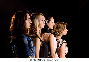Four beautiful teenage girls in profile