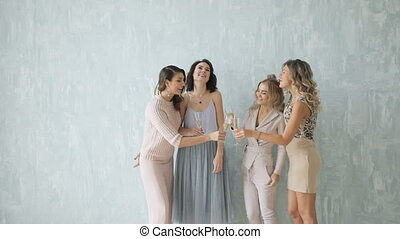 four Beautiful women Sexy happy group of friends at glamorous party lighting sparklers having fun smiling celebrating new year