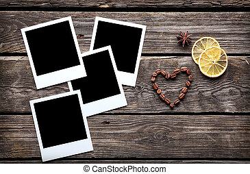 Four blank instant photo frames with coffee beans in shape...