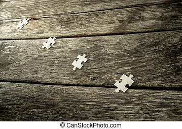 Four blank puzzle pieces lying in a row