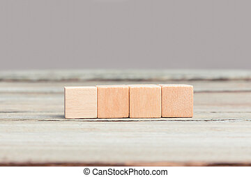Four blank wood cubes