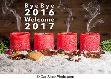 Four blown out advent candles with bye bye 2016 welcome 2017...