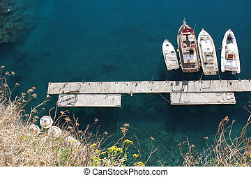 Boats on a landing stage - Four Boats on a landing stage...