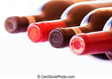 Bottles of red wine - Four Bottles of red wine isolated on a...