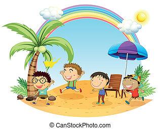 Four boys having an outing at the beach