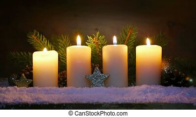 Four burning advent candles and Christmas decoration. -...