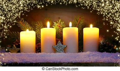 Four burning advent candles and luminous lights. - Christmas...