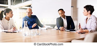 Four business executives collaberating on a new project together