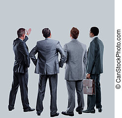 four business mans from the back - looking at something over a white background.