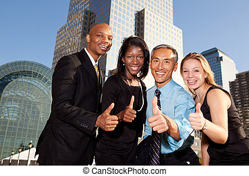 Four Business People - Four business people giving thumbs...