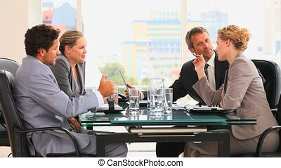 Four business people speaking