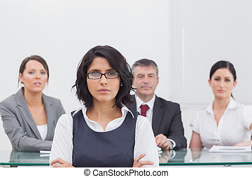 Four business people with serious expressions