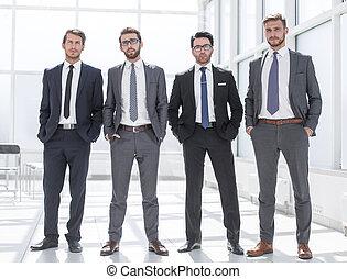 four businessmen standing together