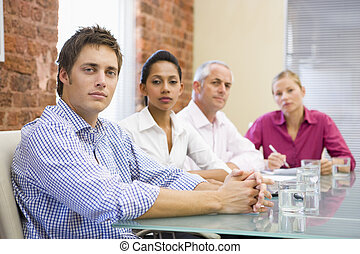 Four businesspeople in boardroom