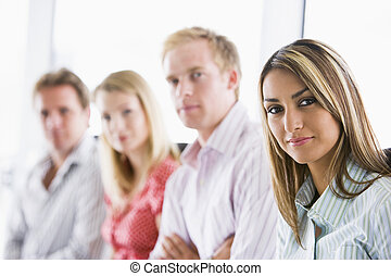 Four businesspeople sitting indoors