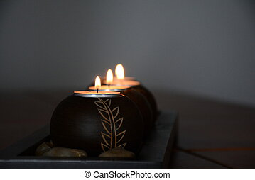 Four candles burn in a dark room-2