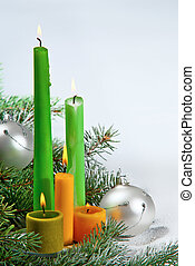 Four Candles with Christmas Twig on the White Background