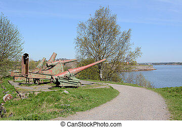 Four cannons pointing out over the water from Suomenlinna