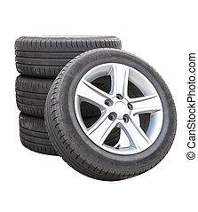 Four car tires on white background