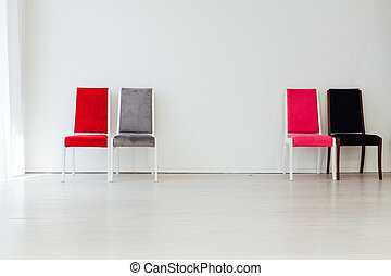 four chairs in the interior of an empty white room