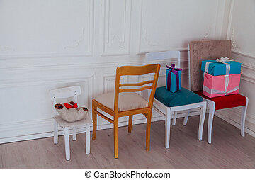 four chairs in the interior of the white room